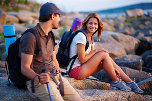 Pretty hiker looking at her boyfriend while talking to him