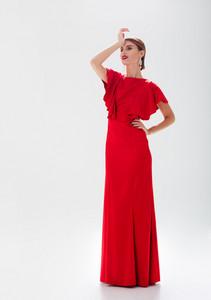 Pretty model in red dress. full length