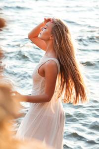 Pretty woman in water. in profile. so beauty