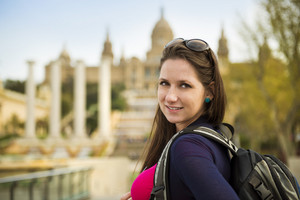 Pretty young female tourist is enjoying the view in Barcelona, Spain.