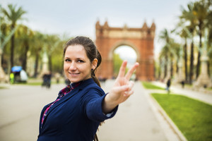 Pretty young female tourist is posing in parc Ciutadella in Barcelona, Spain.