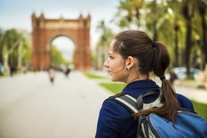 Pretty young female tourist is walking in parc Ciutadella in Barcelona, Spain.