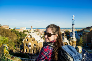 Pretty young female tourist posing in Parc Guell in Barcelona, Spain.
