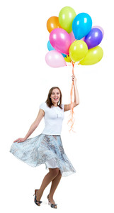 Pretty young woman with colorful balloons laughing