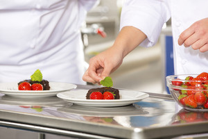 Professional chef decorate dessert cake with strawberry