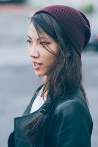 Profile portrait of young beautiful long straight hair asian woman overlooking - hair care, hair style concept