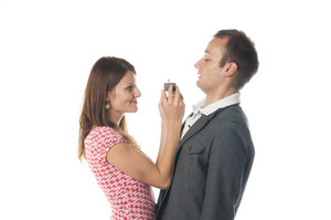 Proposal scene with happy woman and sad man.