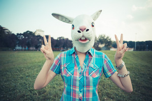 rabbit mask absurd beautiful young hipster woman in the city