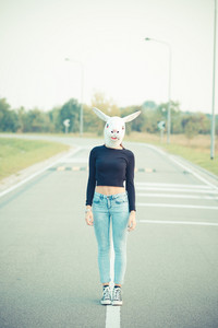 rabbit mask young beautiful brunette straight hair woman outdoor