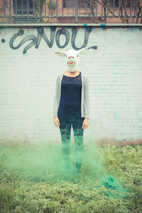 rabbit mask young beautiful brunette woman in the city