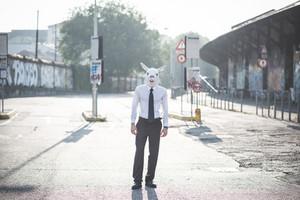 rabbit mask young handsome elegant blonde model man in the city