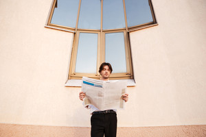 Reading some business news. Businessman