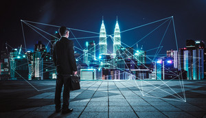 Rear view of a businessman looking at large city center with network connection graph . Concept of success and sociality.
