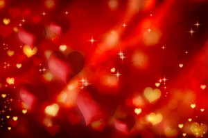 Red and golden hearts on gradient background