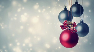 Red and gray Christmas ornaments in snowy night