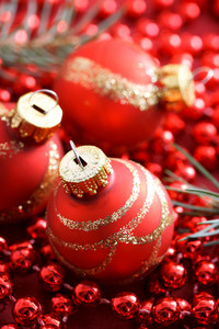 Red Christmas ornaments on beads