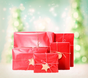 Red gift boxes on christmas trees background