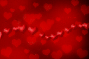 Red hearts on red grunge paper background