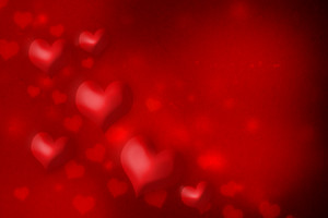 Red hearts on red grungy paper background