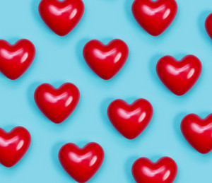 Red shiny hearts on a blue background