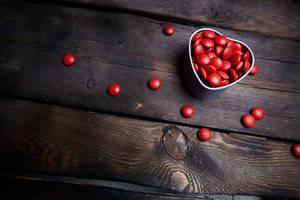 Red small candies in heart shaped box