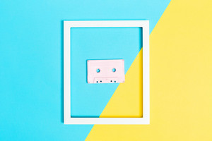 Retro cassette tape and frame on bright duotone background