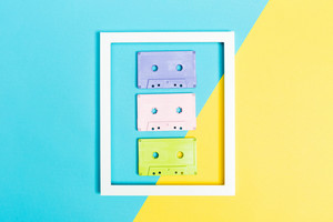Retro cassette tapes and frame on bright duotone background