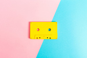 Retro cassette tapes on a bright duotone background