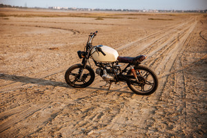 Retro motorcycle standing in the desert
