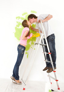 Romantic couple kissing each other during improvement of new flat