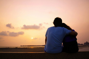 Romantic Mature Couple Enjoying at Sunset on the Beach in Sepang,Malaysia