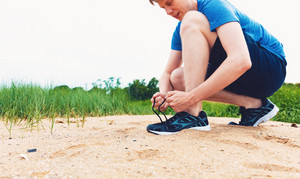Runner preparing to go for a jog outdoors