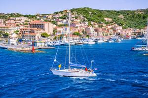 Sailboat in front of Port La Maddalena Island, Sardinia, Italy