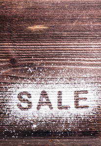 Sale composition. Studio shot on wooden background.
