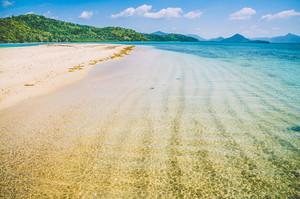 Sandy bank with clear blue water near El Nido, Philippines