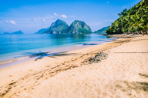 Sandy Beach with Palm Shadows, Huge Rocks in Background, El Nido, Palawan, Philippines