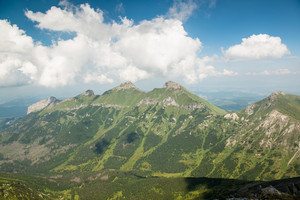 Scenery of high green mountains, blue sky with clouds. High Tatras Slovakia.  Beautiful mountain landscape.