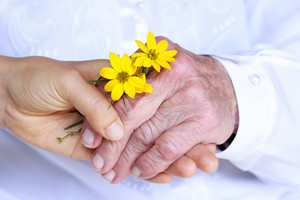 Seninor Lady and Young Woman Holding Hands - Giving Flowers (Friendship, Care, Service)