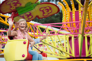 Senior couple having fun in amusement park