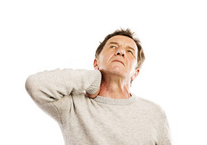 Senior man suffering from neck pain, isolated on white background