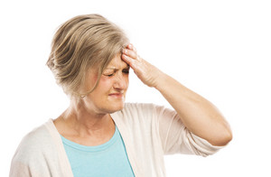 Senior woman has headache, isolated on white background