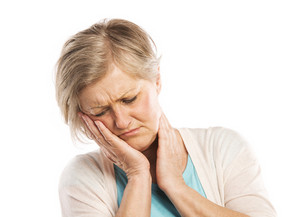 Senior woman suffering from toothache, isolated on white background