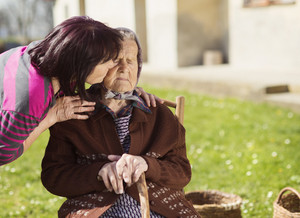 Senior woman with daughter taking care of her