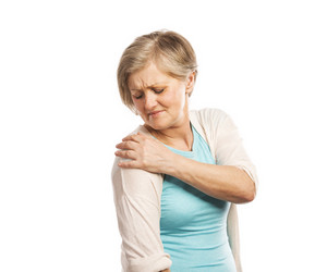 Senior woman with shoulder pain, isolated on white background