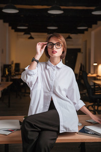 Sensual young businesswoman in glasses