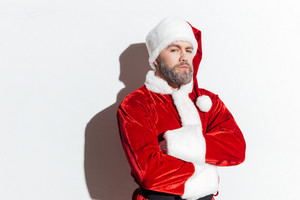 Serious santa claus standing with arms crossed