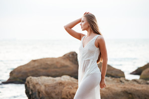 Sexy model on the beach. looking away