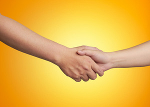 Shaking hands of male and female