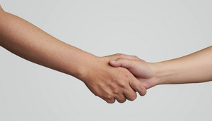 Shaking hands of two male people, with clipping path .