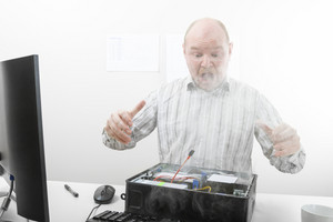 Shocked Businessman Looking At Smoke Coming Out From Computer Ch